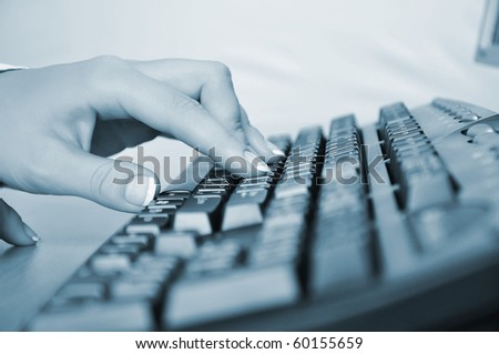 Hands of a young woman presses the keyboard. Workplace businessman - stock photo