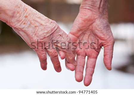Hands of an elderly couple, close-up. - stock photo