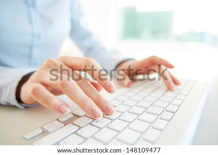 Hands of an office woman typing - stock photo