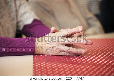 Hands of an old lady. - stock photo