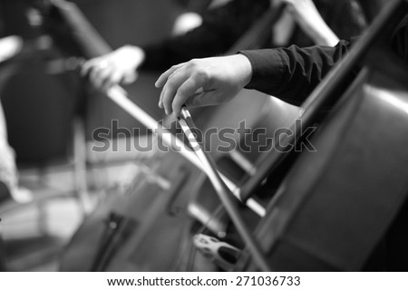 Hands of bassist playing - stock photo