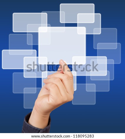 hands of business man, touching a button on blue background. - stock photo