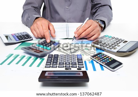 Hands of businessman with calculator. Finance and accounting business. - stock photo