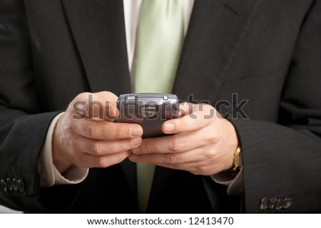 Hands of businessman working on a PDA - stock photo
