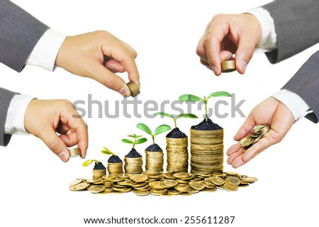 Hands of businessmen giving coins to trees growing on coins in germination sequence - Business growth with csr practice - stock photo