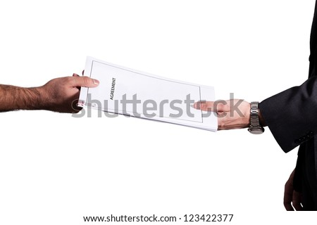 hands of businessmen holding copy of partnership deed or agreement - stock photo