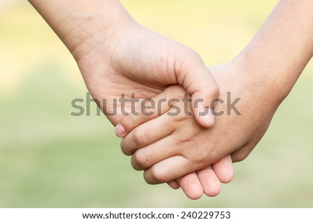hands of children friends, summer nature outdoor - stock photo