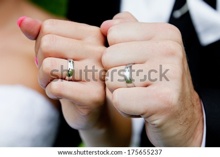 Hands of couple with wedding rings  - stock photo