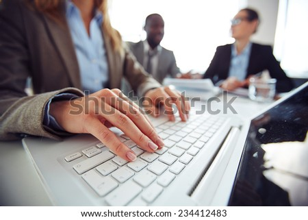 Hands of female employee typing - stock photo