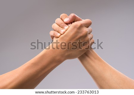 Hands of friends greeting each other - stock photo