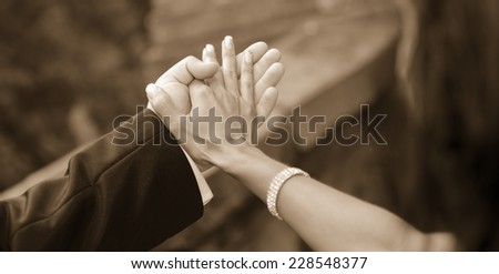 hands of groom and bride together for dance vintage edit - stock photo