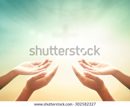 Hands of man praying over blurred crown of thorns and the cross on a sunset. Thanksgiving Christmas Health Care Worship Forgiveness Repentance Reconcile Adoration Glorify Redeemer Pentecost concept. - stock photo
