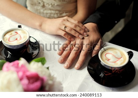 Hands of married people. Coffee. - stock photo