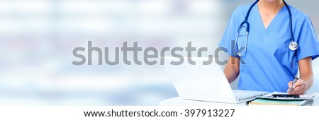 Hands of medical doctor woman with laptop. - stock photo