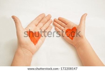 Hands of mother and child painted with red hearts, concept of love. Point of view shot - stock photo