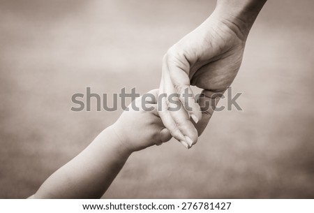 hands of mother and child. vintage tone - stock photo