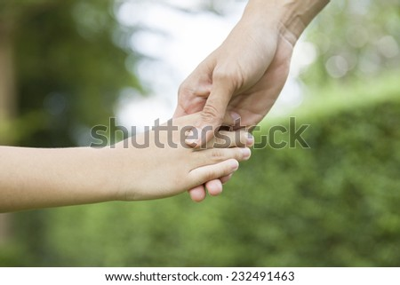 Hands of mother and son  - stock photo