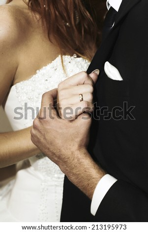 Hands of newlyweds dancing their first wedding dance - stock photo