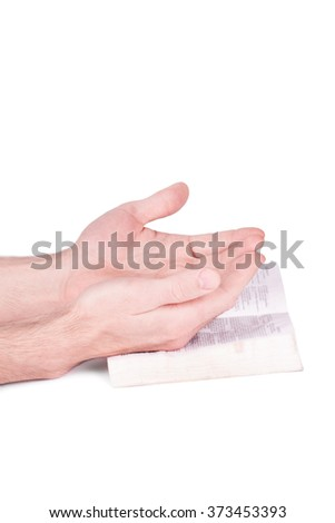 Hands  of praying in solitude with Bible isolated on white background  - stock photo