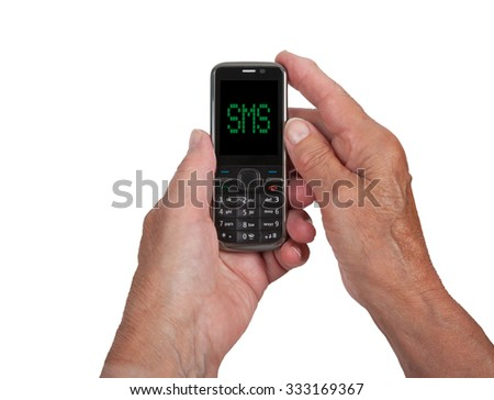 Hands of senior woman with a mobile phone, SMS - stock photo