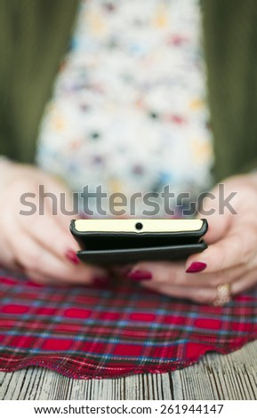 hands of senior woman with  smartphone  - stock photo