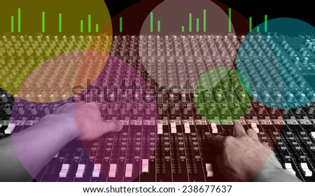 hands of sound engineer work on recording studio mixer & colorful bokeh for music concept background - stock photo
