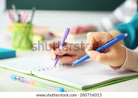 Hands of students at school, close up - stock photo