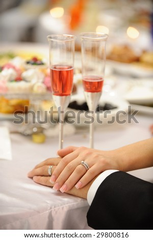 Hands of the bride and groom - stock photo