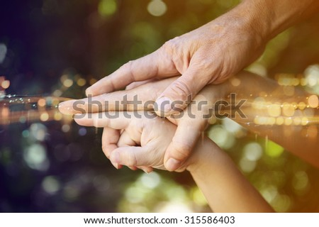 hands of the family, dynamic composition. - stock photo