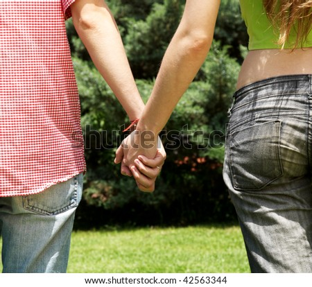 Hands of the man and the woman keep together - stock photo