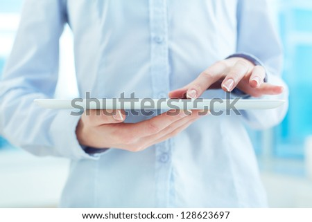 Hands of white collar worker using touchpad - stock photo