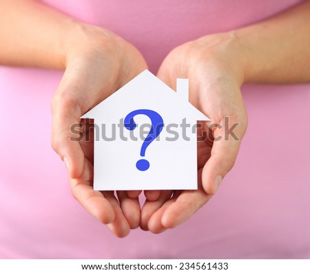 Hands of woman holding paper house - stock photo