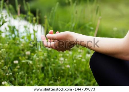 Hands of woman meditating - stock photo