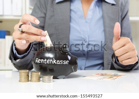 Hands of woman paying money for pension fund  - stock photo