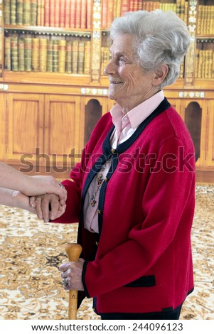Hands of young and senior women - stock photo