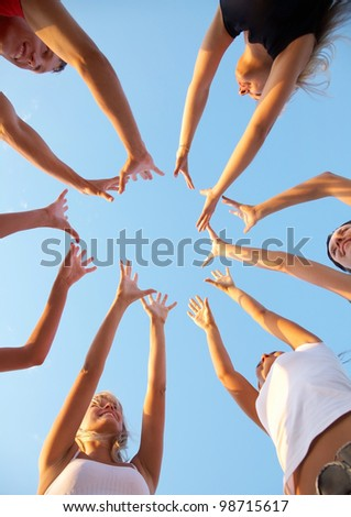 hands of young people stretching to the center - stock photo