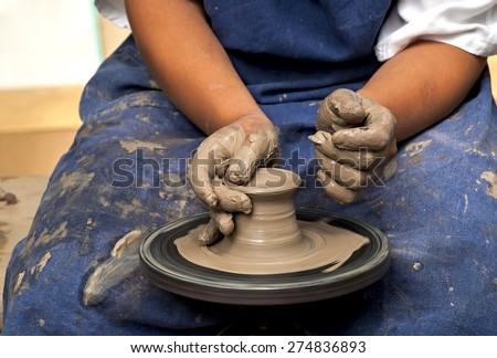 Hands of young potter, was produced on range of pot - stock photo