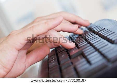 Hands on computer keyboard  - stock photo