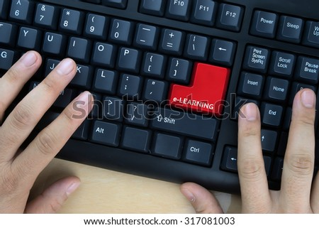"Hands on computer keyboard with ""e-Learning"" words at enter button. - stock photo"