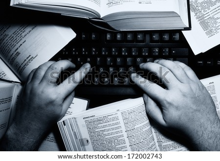 Hands on keyboard symbolizing overloaded writer or any job or studies involving lot of typing and working with a computer. - stock photo