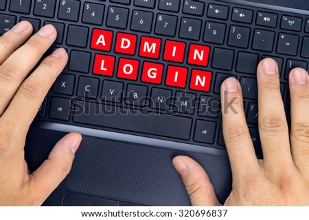 """Hands on laptop with """"ADMIN LOGIN"""" words on keyboard buttons. - stock photo"""