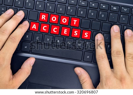 "Hands on laptop with ""ROOT ACCESS"" words on keyboard buttons. - stock photo"