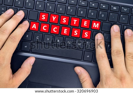 "Hands on laptop with ""SYSTEM ACCESS"" words on keyboard buttons. - stock photo"