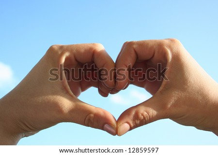 Hands on sky - stock photo