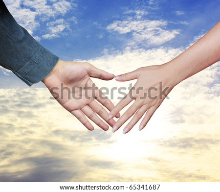 Hands on sky - stock photo