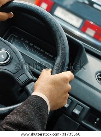 Hands on stearing wheel - stock photo