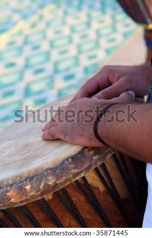 Hands on the african drum - stock photo