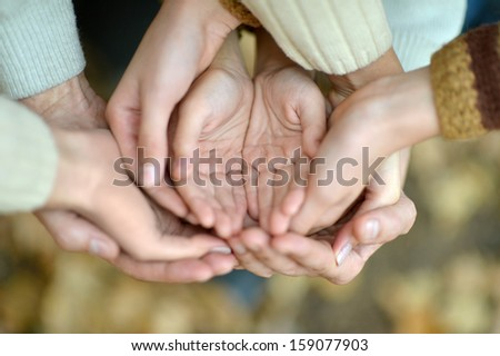 hands on the background of autumn nature - stock photo