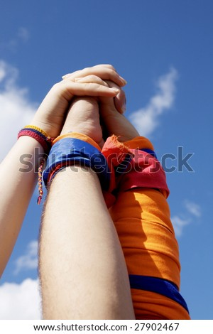 Hands on top of each other. Symbolic picture - stock photo
