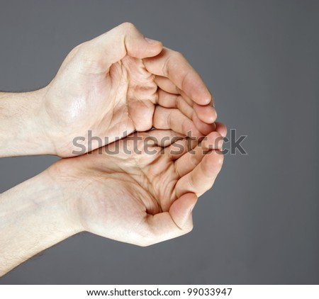 Hands open isolated on grey background - stock photo